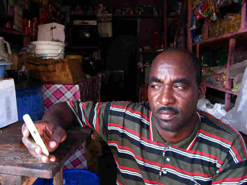 Larousse Dorcent runs a  small grocery store out of a shipping container in the Haitian port city of  Saint Marc. In  December, Dorcent started accepting payments at his shop by cell phone.