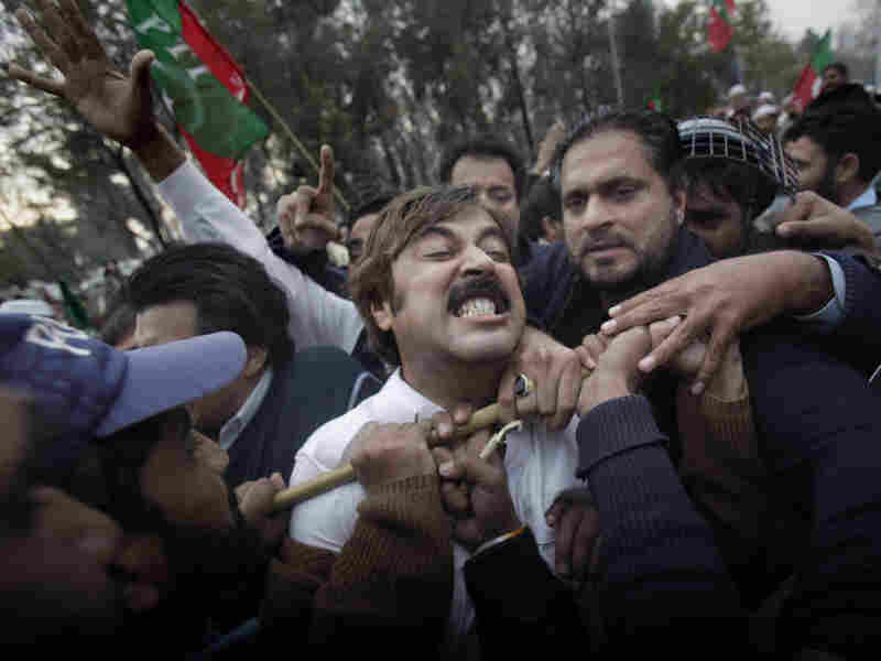 Pakistani demonstrators scuffle with police blocking them from reaching the U.S. embassy during a protest in Lahore.