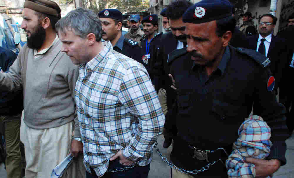 Pakistani police escorted the U.S. consular official, identified by local authorities as Raymond Davis, into court in the city of Lahore on Friday.