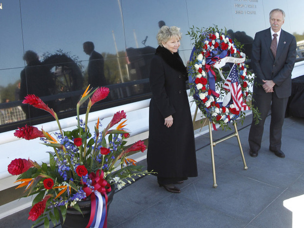 June Scobee Rodgers, left, widow of Dick Scobee, and William Gerstenmaier, NASA associate administrator for space operations, place a wreath at the Space Mirror Memorial today.