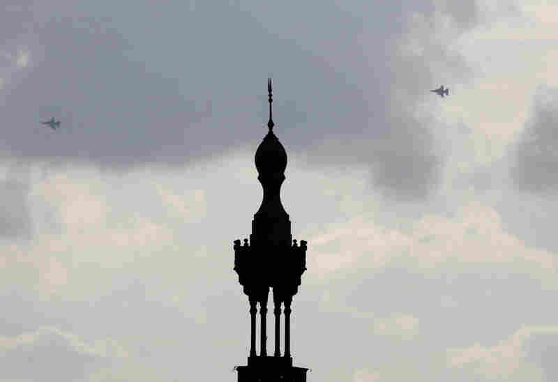 Military fighter jets share the sky with the minaret of the Aguza mosque in Cairo on Sunday.