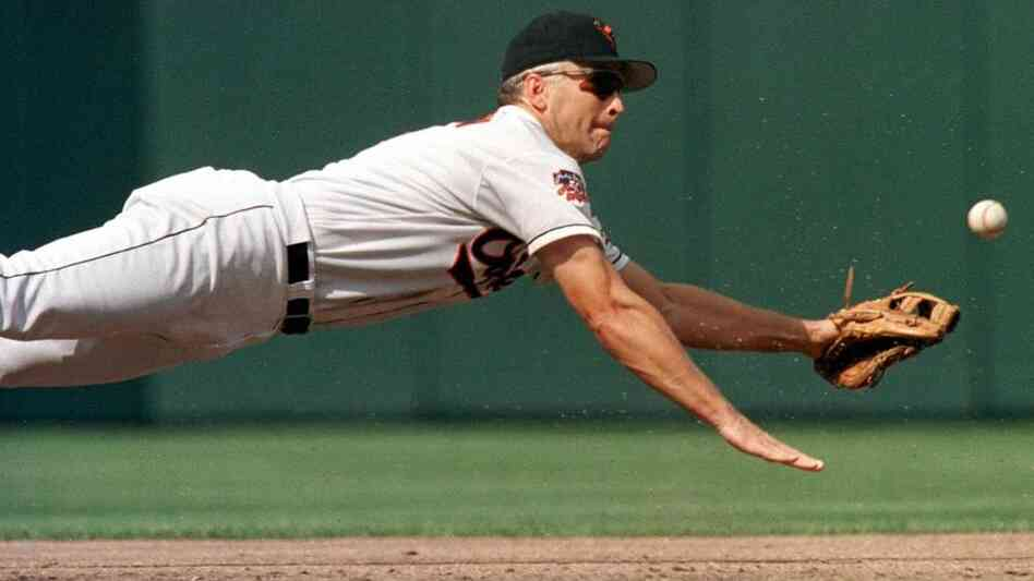 Baltimore Oriole Cal Ripken Jr. dives for a ball during a game against the Cleveland Indians on Sept. 15, 1997.