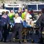 Emergency personnel attend to a shooting victim  outside a Safeway in Tucson, Ariz. Rep. Gabrielle Giffords (D-AZ), and others were shot as the congresswoman was meeting with constituents. First responders to the scene used special first aid kits to help treat victims until medical personnel arrived.