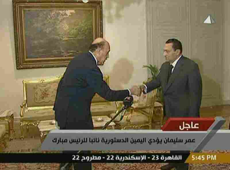 In this image from Egyptian state television, Egyptian intelligence Chief Omar Suleiman (left) takes the oath of vice presidency in front of President Hosni Mubarak.