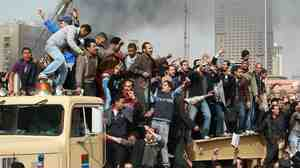 Protesters cheered and chanted earlier today (Jan. 29, 2011) as they rode on an Army truck that was rolling into Cairo's Tahrir Square.