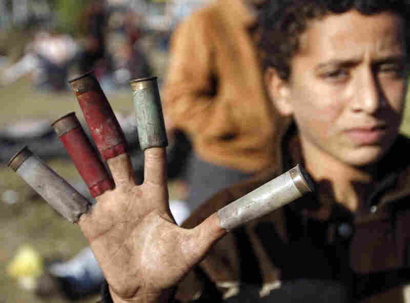 A boy shows spent cartridges used by Egyptian security forces in Cairo on Sunday.