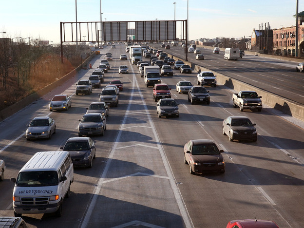 Motorists navigate the morning rush hour in Chicago. Ford and other major automakers hope to install technology in cars that enables vehicles to communicate with one another to avoid crashes.