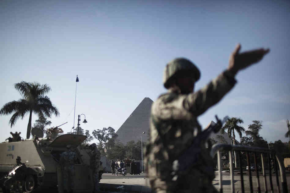 Egyptian army soldiers take position in front of the Giza pyramids on Monday.