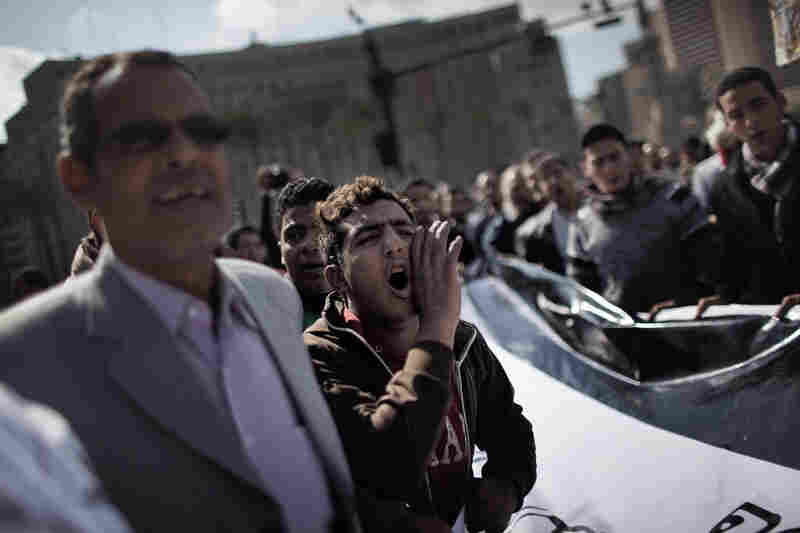 An Egyptian demonstrator shouts anti-government slogans in Tahrir Square demonstrations on Monday.