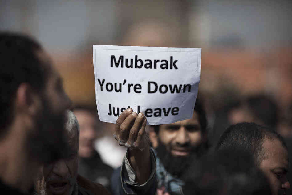 A demonstrator holds a sign in Tahrir Square on Monday.