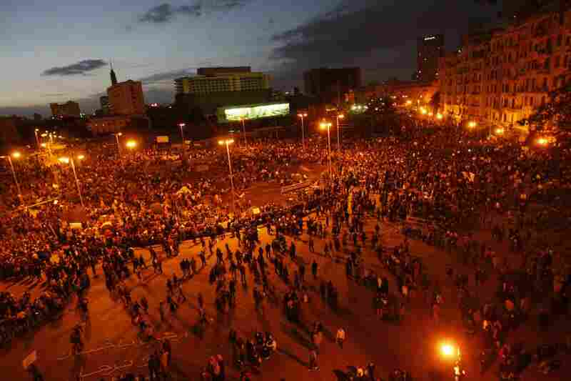 Egyptian demonstrators gather at dusk in Tahrir Square in Cairo on Monday, the seventh day of protests against long term President Hosni Mubarak. (Mohammed Abed/AFP/Getty Images).