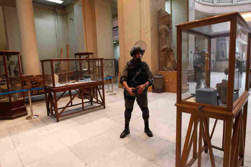 Vandals broke into Cairo's famed Egyptian Museum on Monday, damaging two mummies and about 75 small artifacts before being caught and detained by army soldiers.
