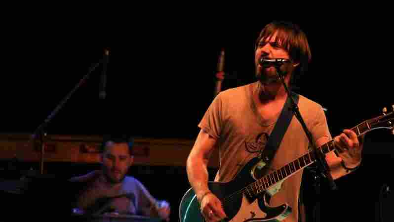 Matt Baum (left) and Conor  Oberst (right) of the band Desaparecidos perform at the benefit.