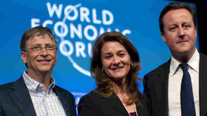 Microsoft founder Bill Gates, his wife Melinda French Gates and British Prime Minister David Cameron at the World Economic Forum on January 28, 2011, in Davos, Switzerland.