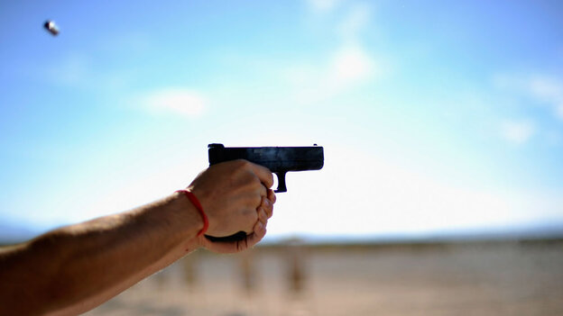 People shoot  their guns at a shooting range near the Crossroads of the West  Gun Show in Tucson, Ariz., on Jan. 15.