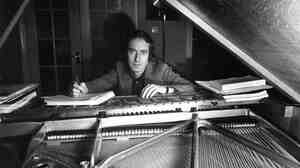 John Barry at his piano