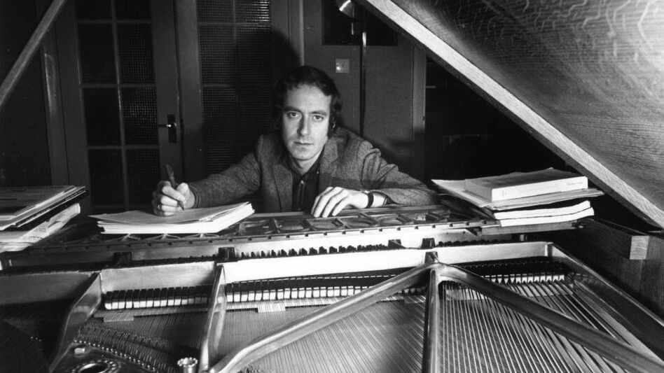 John Barry at his piano in 1967, the year both<em> Born Free</em> and <em>You Only Live Twice</em> — the fourth of the 11 James Bond films he scored — were released in theaters.