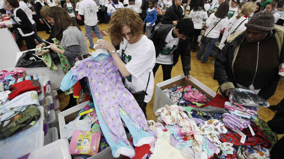 Volunteers for The Salvation Army sort children's pajamas