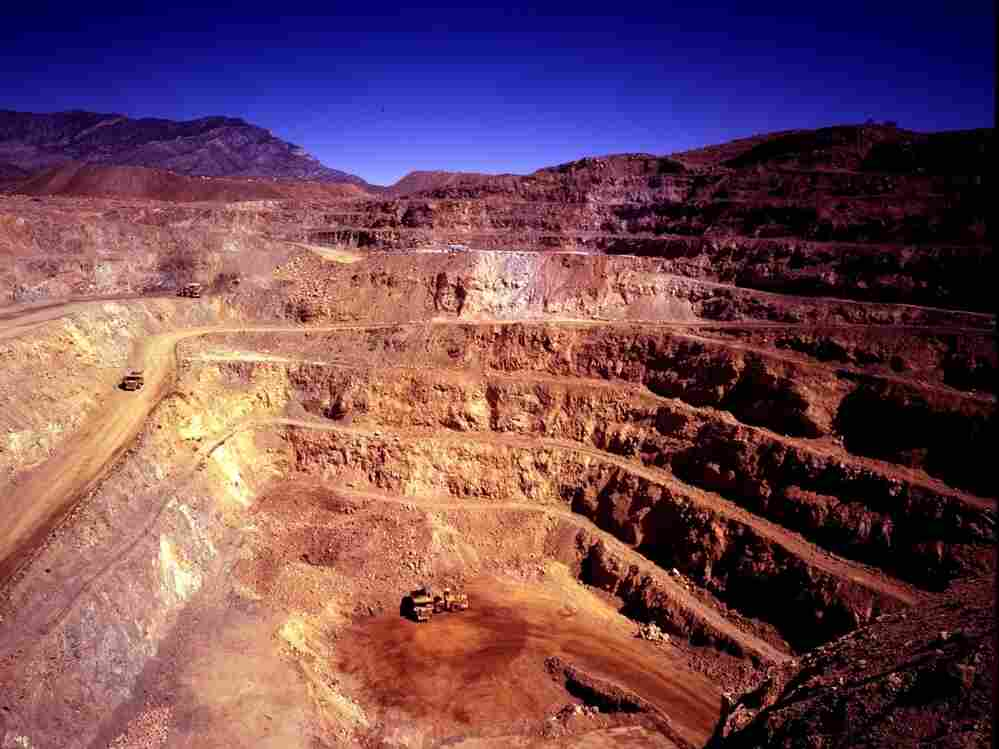 The open pit mine at Molycorp Minerals' rare earths mining and processing facility in Mountain Pass, Calif. The mine is expected to produce 40,000 tons of rare earth minerals each year after a $500 million expansion project.