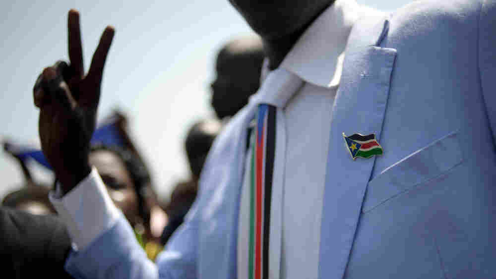 A man dressed in Southern Sudan paraphernalia — a pin and tie — celebrates the announcement of the preliminary results of the independence referendum in Juba on Sunday.