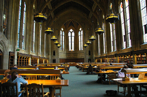 """Students study in Suzzallo Library at the University of Washington in Seattle. The authors of Academically Adrift find that in the first two years of college, """"With a large sample of more than 2,300 students, we observe no statistically significant gains in critical thinking, complex reasoning, and writing skills for at least 45 percent of the students in our study."""""""