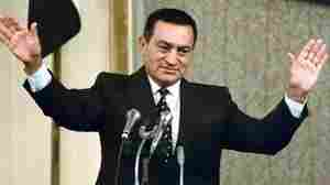 "Mubarak waves to parliament on Oct. 12, 1993, after being sworn in for a third six-year term as President. He was the only presidential candidate and won a 96 percent ""yes vote"" in a national referendum on Oct. 4."