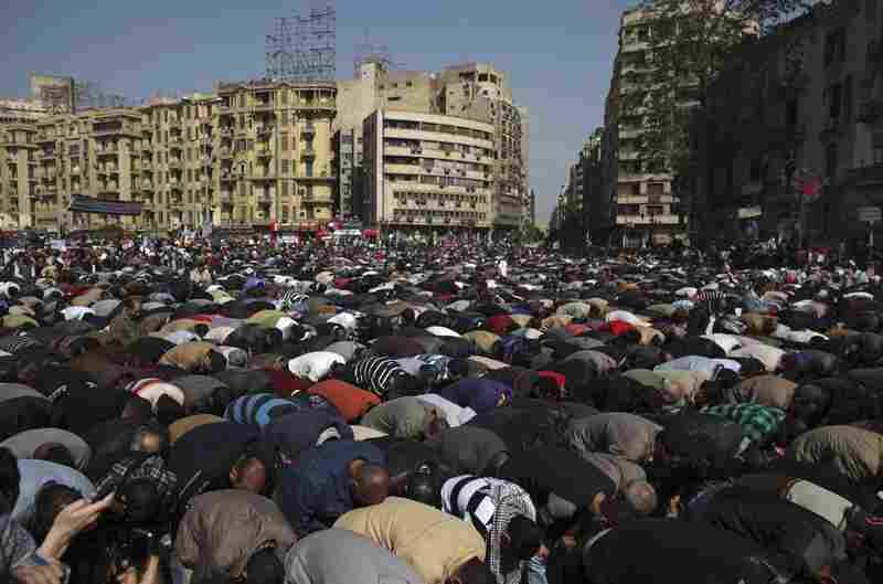 Demonstrators pray in Tahrir Square during the largest demonstration in a week of constant protest.