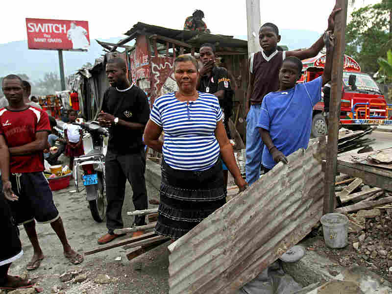"""Louisanna  Dema has lived along the median of Route Nationale 2, just south of  Port-au-Prince, for just over a year.  She and her family are finally moving out  of their sheet metal shack and into a """"transitional shelter"""" provided by a  relief agency."""