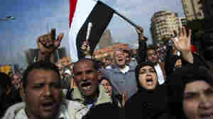 Anti-government protesters marched toward Tahrir, or Liberation, Square in downtown Cairo on Tuesday. Troops and tanks guarded the square, but the army promised Monday night that it would not fire on demonstrators.