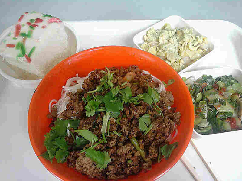 Shanghai, China, 2006. Rice-flour bread, egg and cauliflower, cabbage, and wheat noodles with pork.