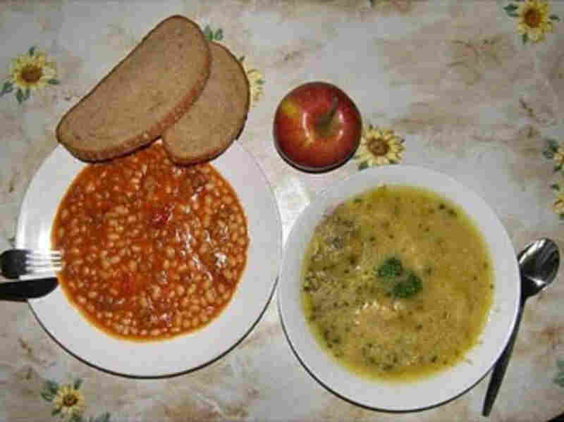 Ústí nad Labem, Czech Republic, 2010. Beans with tomato sauce, pea soup, apple, wheat and rye bread.