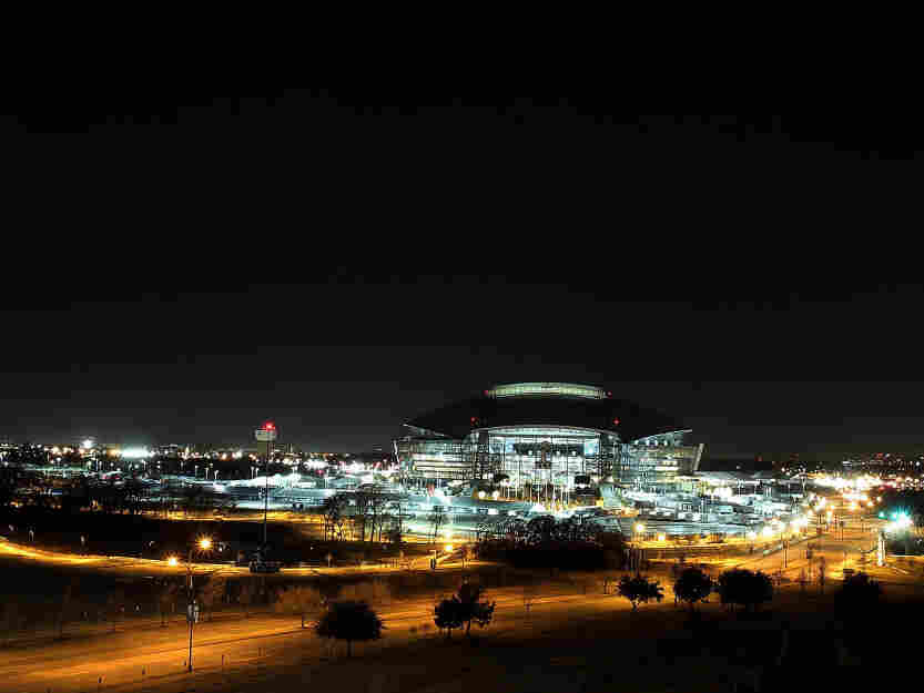 A view of the Cowboys Stadium at night in Arlington, Texas. The Dallas suburb will host Super Bowl XLV between the Pittsburgh Steelers and the Green Bay Packers at Cowboys Stadium on Feb. 6. Dallas hopes its existing sports infrastructure will help the city win the bid for the 2020 Summer Olympic Games.