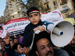 An Egyptian boy holds a megaphone while protesting in Tahrir Square in central Cairo, Egypt.  Protests continued unabated as thousands march to demand the resignation of Egyptian President Hosni Mubarek.