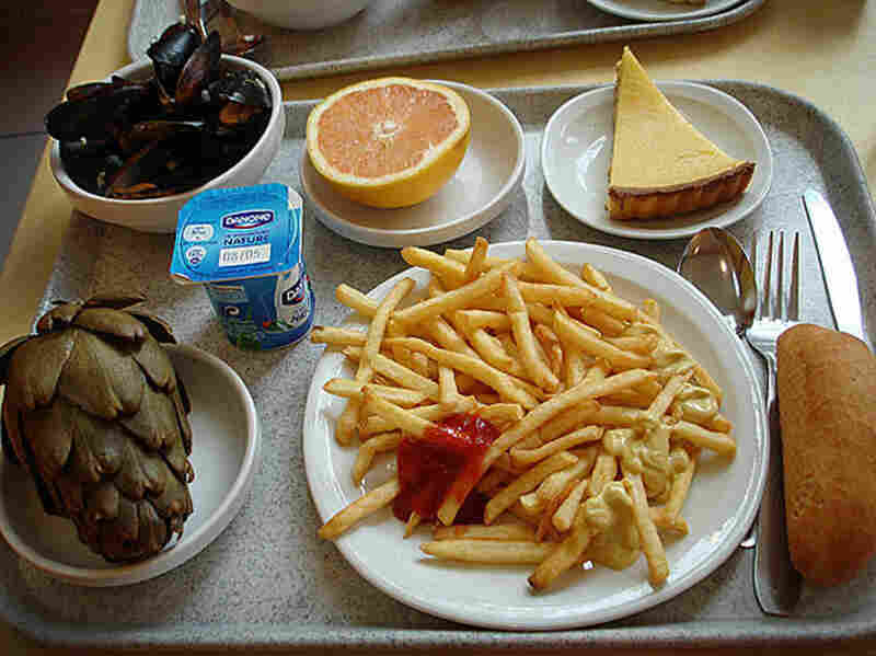 Saint Etienne, France, 2009. Mussels, grapefruit, lemon tart, roll, french fries, yogurt and an artichoke.