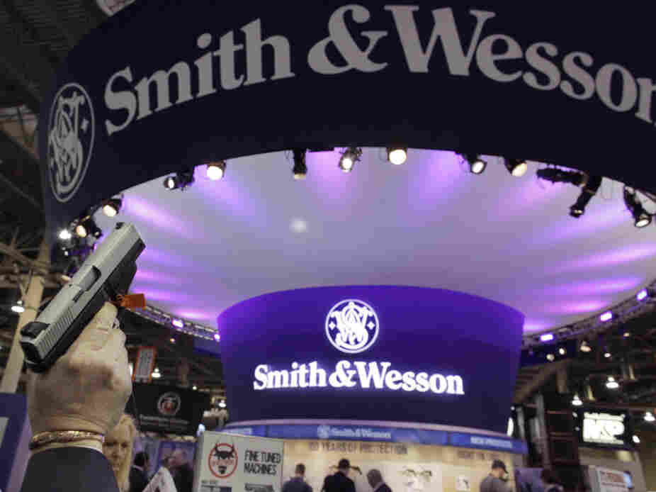 A retailer examines a Smith & Wesson hand gun at the Shooting, Hunting and Outdoor Trade show in Las