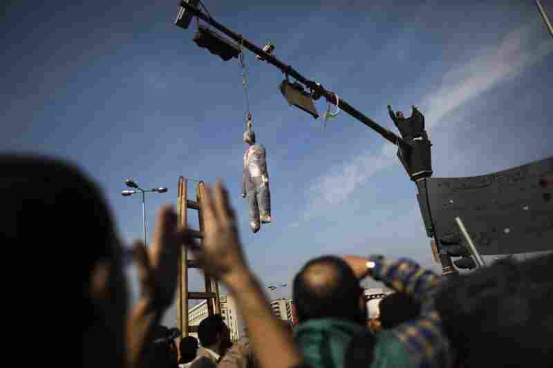 An effigy depicting President Hosni Mubarak is hung on a traffic light in downtown Cairo.