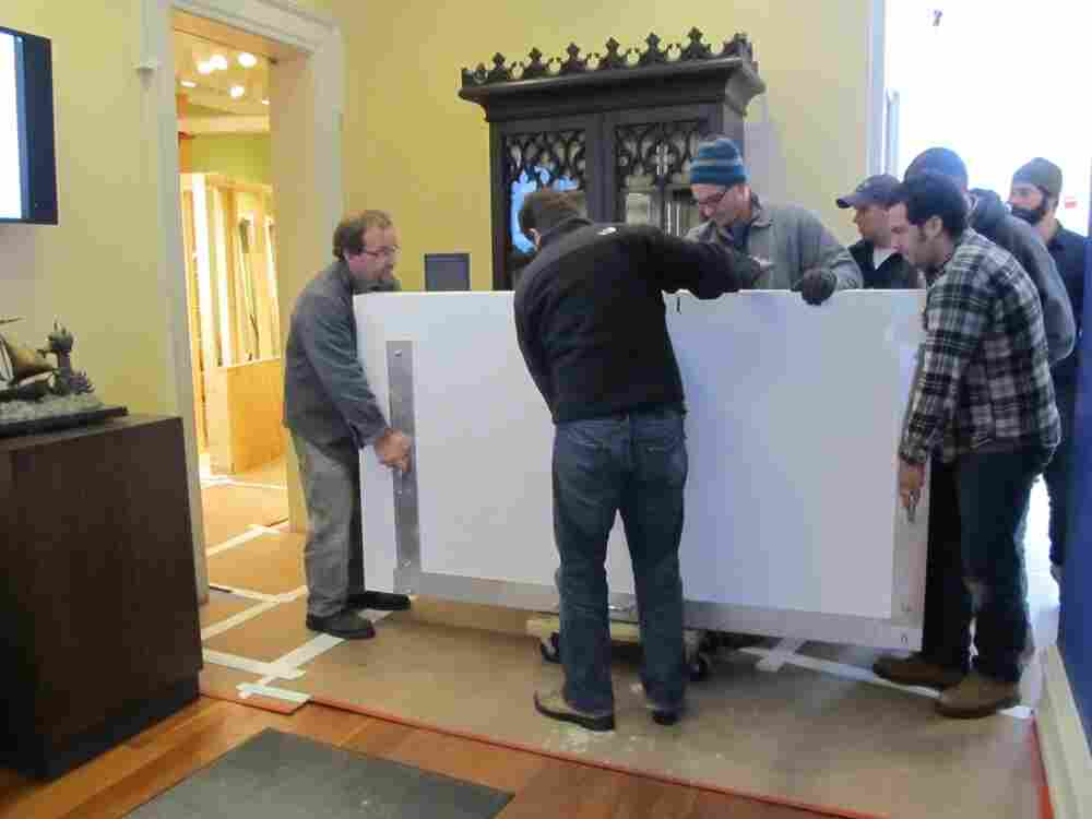 A team of eight art handlers and  conservators transported The Chertoff Mural from the truck into the Rosenbach Museum & Library's Maurice Sendak  Gallery.