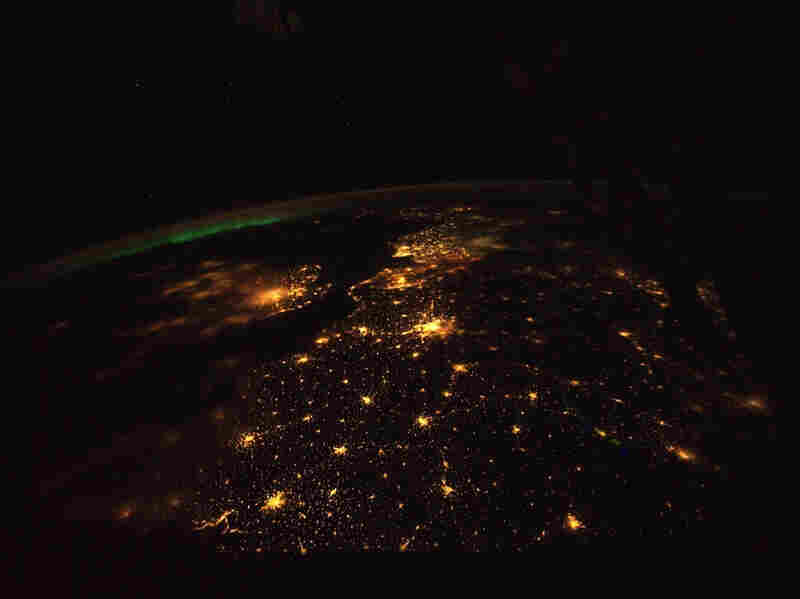 The English Channel,  shown here, lies between the light-polluted United  Kingdom, the smaller land mass to the left, and continental  Europe. London and its suburbs light up the image, just  left of center.