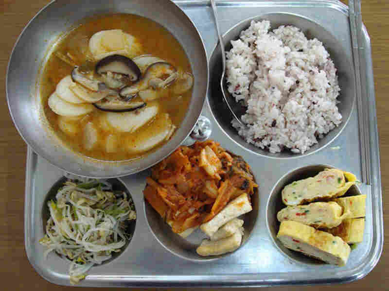 Yoengju, South Korea, 2008. Mushroom soup, rice, egg, tofu, kimchi and brean sprouts.