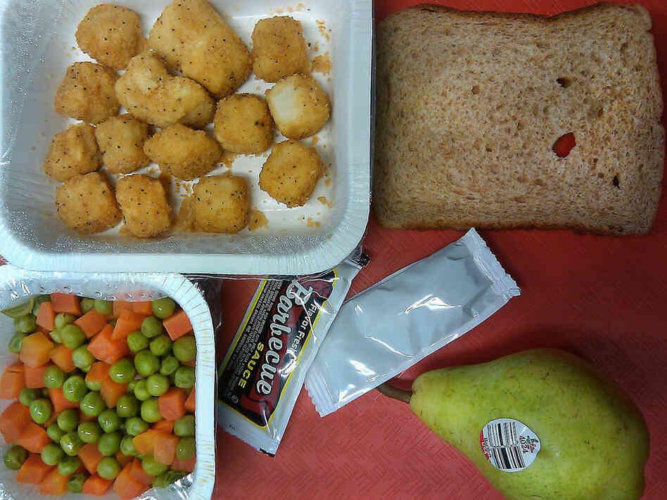 Illinois, 2010. Popcorn chicken, bread, pear, peas and carrots.