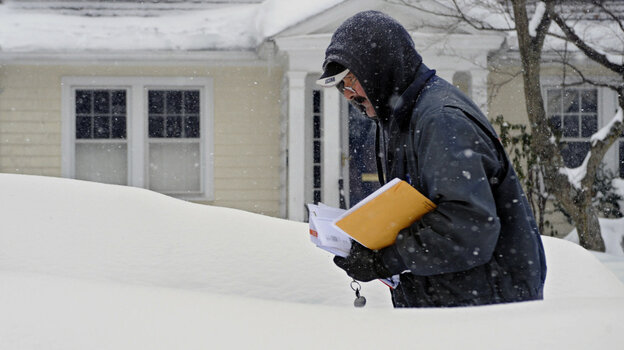 Don Jacques delivers mail during a winter storm Tuesday in Hartford, CT.