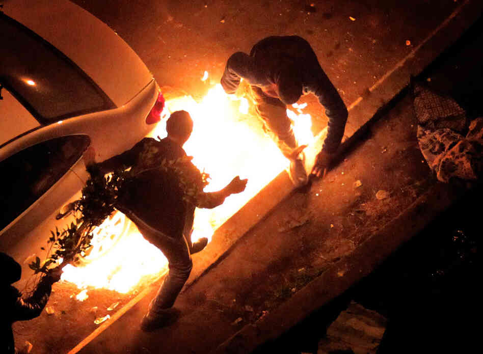 Anti-government protestors get caught by a petrol bomb thrown by pro President Mubarak supporters near Tahrir Square.