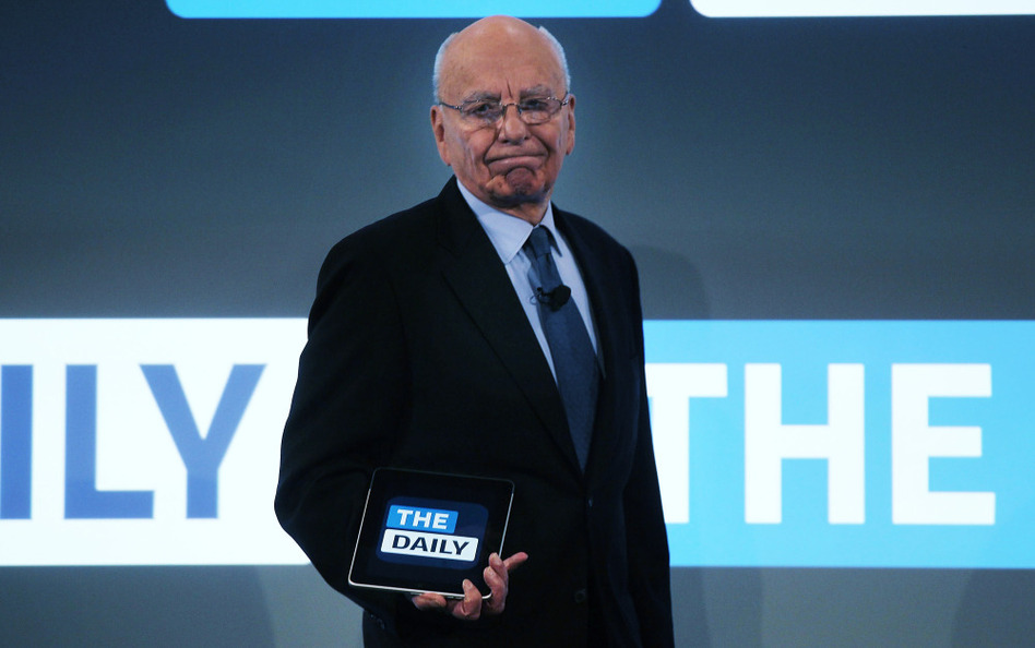 News Corp. CEO Rupert Murdoch walks on stage with an iPad for the launch of his new online newspaper for the Apple iPad called The Daily.