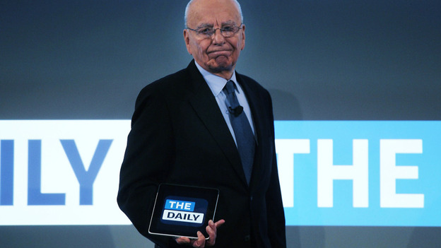 News Corp. CEO Rupert Murdoch walks on stage with an iPad for the launch of his new online newspaper for the Apple iPad called The Daily. (Getty Images)