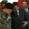 Jordan's King  Abdullah II (left) listens to now-Prime Minister Maaruf Bakhit during the inauguration  of a new army program in the town of Zarqa, near  the capital Amman,  Nov. 5, 2007.