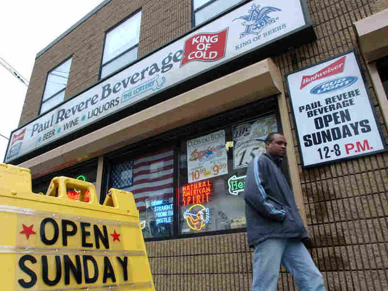 A pedestrian walks past Paul Revere Beverage in Somerville, Mass., in this photo from 2004 — the year the state ended its ban on Sunday alcohol sales. Since 2002, 14 states and numerous municipalities have repealed such bans.