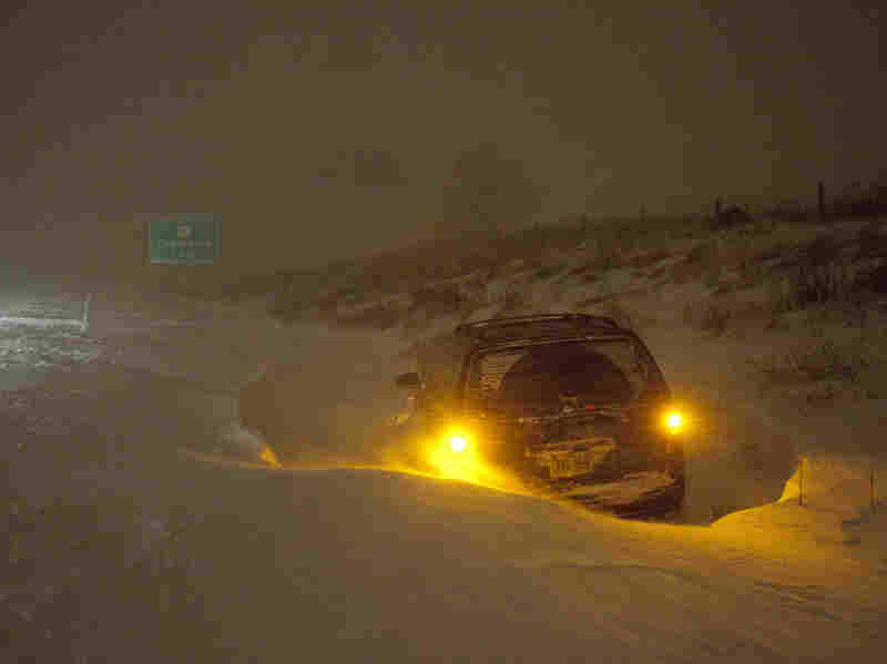 A vehicle is stranded on Interstate 43 Wednesday, Feb. 2, 2011, in Grafton, Wi. The area is under a blizzard warning and some freeways were shut down.