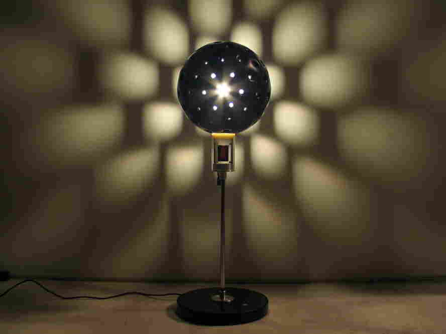 A lamp shade robot, an Auger-Loizeau Carnivorous Domestic Robot Entertainment design, is powered by incoming flies.