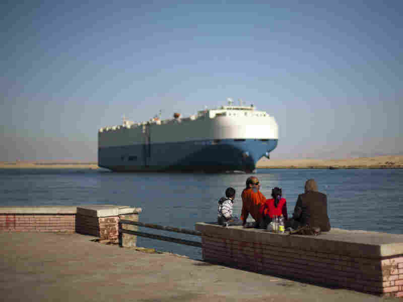 A cargo ship transits the Suez Canal en route from the Mediterranean Sea to the Gulf of Suez at the city of Suez, Egypt, on Wednesday.