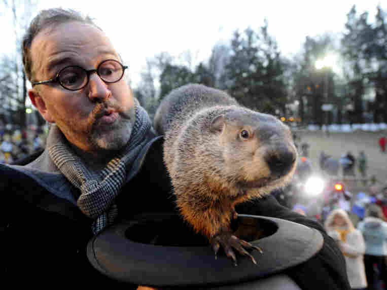 Groundhog handler Ben Hughes and Punxsutawney Phil earlier this morning.